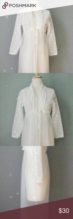 "Vintage White Lace Robe Romantic This pretty white robe is made of a lace top and a sheer bottom. It has no closures. It has an empire waist that is elasticized and that kind of fits under the bust or around the outer edges of the bust.  Label: Belle Smith  bust: 30"" empire waist: 10 1/2"" stretching comfortably to 15"" hips: free length: 50  Excellent condition!  Thanks for looking! 20101 Vintage Intimates & Sleepwear Robes"