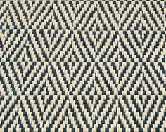 Elizabeth Eakins offers hand-hooked rugs made with care from natural fibers.