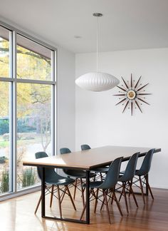mid-century modern decor. Nelson bubble light, grey modernica chairs