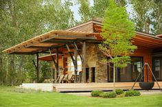 This beautiful Ruby Springs prefab home should put to bed the claims that prefab homes are boring. This place is beautiful- customizations: rock fireplace and facade, roll up wall, cork flooring, solar power, and most of the woodwork is done with reclaimed Douglas fir.