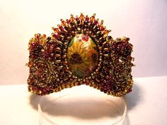 Sunflower cuff.  I like this one because I tried a new technique when I made the cabochon and it worked out well