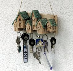 Exactly is lifeless, so my works of clay are anything but exact. By certain proceed becomes my castles an ancient appearance. No castle is like an another one. For the people who search the ununsual! Keyholder for your wall With this keyholder it is easy to keep order ;-). In each house , a hook is attached . You can hang 6 keys on it. You can hang it on the wall with two nails or with a cord. Lenght 25 cm ( 9,84 inches) Height 11 cm ( 4,33 inches) Width 6,5 cm ( 2,55 inches) Weight 900gr…