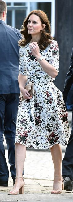 The Duchess showed her support for local designers by carrying a clutch by Polish brand Et...