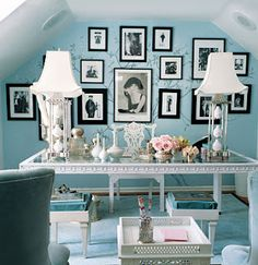 Tifffany blue walls - love the antique white mirrored desk with vintage photos behind.