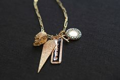Jennifer's signature  build-your-own necklace , featuring rose gold and diamond-encrusted dog tags.