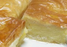 Galaktoboureko (Greek Custard-Filled Phyllo Dessert) This is my favorite Greek dessert. My cousin grew up with a Greek girl and we've had this recipe in the family ever since! Greek Sweets, Greek Desserts, Just Desserts, Delicious Desserts, Yummy Food, Turkish Dessert Recipes, Greek Food Recipes, Greek Pastries, Kolaci I Torte