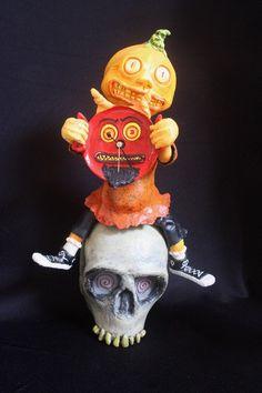 paper mache skull with pumpkin guy & devil clock