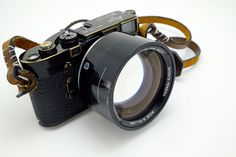 Meet the De Ould Delft 50mm f0.75 Lens - and Leica M3 black paint (re-paint by the look of it) with leather strap.