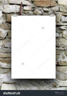 Single blank frame hanged by clips against ancient stone wall background