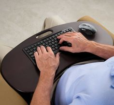 The Wireless Lap Desk Keyboard - This is the lap desk with a built-in wireless keyboard that allows users to type on a computer from wherever they feel most comfortable. A USB radio transmitter connects a computer wirelessly to the integrated full-size keyboard and included wireless mouse from up to 30 feet away. Freed from...