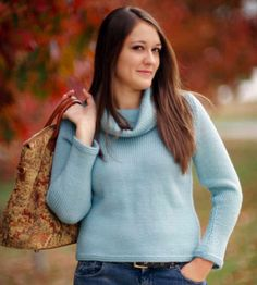 Knit with soft wool yarn, this classic cowl-neck sweater features tapered sides for extra flair. With garter-stitch accents at the hems, this beauty is an easy project for any knitter.