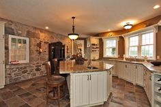 cream color kitchen cabinets and slate floor | original Dining room with woodburning fireplace with marble mantle ...
