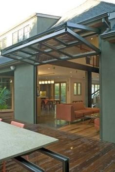 Glass garage door to outdoor patio area opens entire wall to the ...
