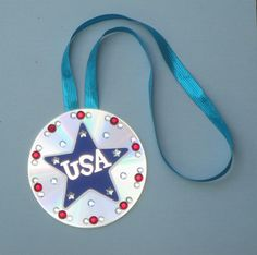 4th of July bike parade prize or decoration- CD turned into medal with a star, jewels and ribbon. Copyright Pamela Maxwell 2013