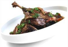 Slow roasted Gressingham Duck® legs with a red wine and mushroom sauce.