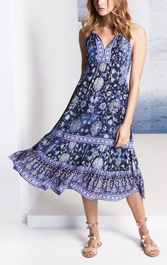New spring wardrobe addition from Rebecca Taylor! A pretty paisley print in a palette of watery blues brings boho charm to this breezy silk midi dress with a split neck and body-skimming fit.