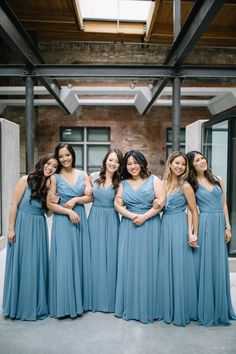 This long chiffon bridesmaid dress in slate blue will look flattering on all of your maids. | Whims and Joy Photography