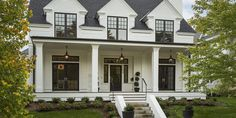 Benjamin Moore White Dove modern farmhouse with black window trim and front door. Small Farmhouse Plans, Modern Farmhouse Design, Modern Farmhouse Exterior, Farmhouse Style, White Farmhouse, Farmhouse Trim, Farmhouse Frames, Modern Barn, Farmhouse Ideas