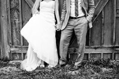 bride groom holding hands in front of a rustic barn | berwood hill wedding in lanesboro mn | photo: guytanomagno.com