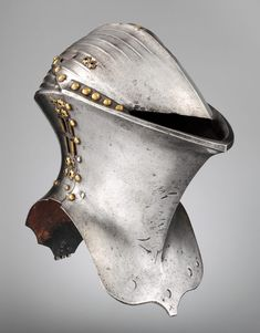 The helm formed part of a highly specialized tournament armor worn solely for the Gestech, or German joust, fought with blunted lances. The object was to break lances or unhorse the opposing rider. This helmet was probably part of a series of armors kept in the Nuremberg arsenal for use in civic tournaments | ca. 1500 | Steel, copper alloy | Credit Line: Bashford Dean Memorial Collection, Gift of Edward S. Harkness | 1929