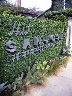 Photos for Hotel San José - Yelp Hotel Signage, Wayfinding Signage, Signage Design, Vertical Garden Wall, Garden Wall Art, Environmental Graphic Design, Environmental Graphics, Monument Signage, Visual Merchandising