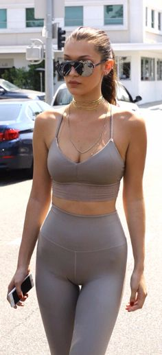Bella Hadid in skintight, figure-revealing clothes with visible bra cups and straps. How does she breathe?