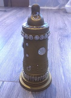 Cute gift for babyshower. I used gold spray on a baby bottle. Use your imagination to decorate it. MN