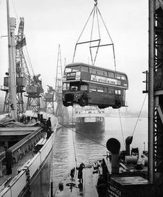 Busman's Holiday April One of two London Routemaster double decker buses being loaded onto the Edelgarde at Millwall Docks, to be transported to Oslo to carry visitors to and from the trade fair as part of 'British Fortnight'. Vintage London, Old London, Richard Branson, London Docklands, Highgate Cemetery, London History, Tudor History, British History, Routemaster