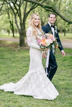 """Kim said yes to her custom Anne Barge lace wedding dress at Elizabeth Johns Bridal! The bride said """"I do"""" at the Fairmount Park Horticulture Center in Philadelphia in Spring."""