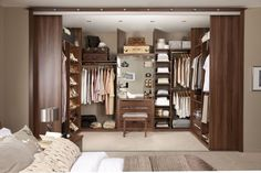 Cool and Smart Custom Closet Systems : Closet And Wardrobe Designs Clean And Elegant Brown Single Woman Walk In Closet Design In Small And Minimalist With Wooden Furniture Cool And Smart Saving Space Ideas For Clothing Lines Jewelry Sho