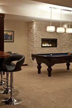 Contemporary Basement Design with Gas Fireplace Inserts, Pool Table, Stone Wall and Bar