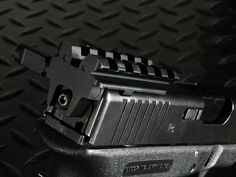 The Strike Industries has added to its ever growing line of Glock products with its SI Rear Sight Rail Adapter for the Glock. The SI GSR is a tactical light weight, ultra sturdy, inexpensive solution for shooters wanting to add a rear sight to their Gl Glock Accessories, Tactical Light, Assault Weapon, Shooting Targets, Picatinny Rail, Edc Everyday Carry, Weapons Guns, Tactical Gear, Airsoft