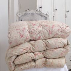 Vintage Eiderdowns are a great way to give a touch of colour to your All White interiour