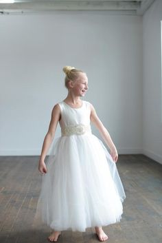 759d166f71038 A white silk and tulle first communion dress in a ballerina style with  diamanté. Holy