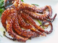 Octopus is first tenderized, then lightly grilled and dressed with lemon and olive oil.