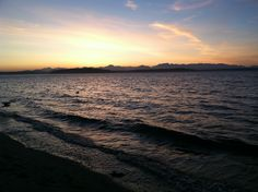 Alki Beach, WA (located in West Seattle) My favorite place to catch some rays in the Summer.