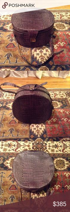 Dooney & Bourke Hat Box, Croc embossed  Dooney & Bourke Crocodile embossed Hat Box, brown leather. Very roomy, two inside pockets and garment ties. Comes with dust cover bag, registration card and original price tag. Gently used, Excellent condition! ❤️ Dooney & Bourke Bags Travel Bags