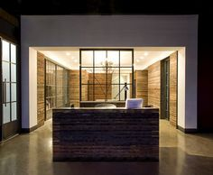 Store interior with good architecture, modern, wood and glass, reception area