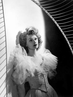 """Lucille Ball in a dress by Edith Head, 1949, photo by Laszlo Willinger  """"Edie [Edith Head] knew the truth about all of us. She knew who had flat fannies and who didn't – but she never told."""""""