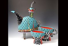 Natalya Sots, darling whimsical ceramic teapot with two matching cups in aqua, red, black and white.