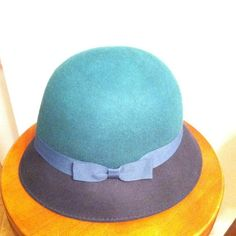 2x HOST PICK Office Chic Party 9/15/14!! This is a green and black block cloche hat with a green ribbon on the side.  It's perfect for the winter because it's made with 100% wool. August Accessories  Other