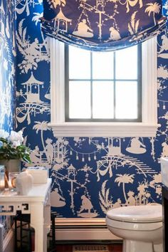 bathroom wallpaper - Thibaut's South Sea navy wallpaper in a powder room by Robin Pelissier  - via Atticmag