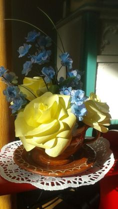 Mother's Day idea terra cotta tea cup with yellow coffee filter roses. Beautiful display.