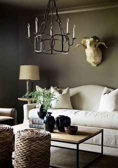 the couch is perfect - curve in the back, no back cushions, overstuffed seat cushion that is a single cushion, could do w/o the dead animal hangin' from the wall though