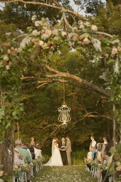 simple chandelier hung from a tree as the alter.