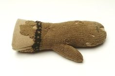 Small knitted woollen mitten. The wool is pale brown. There is a line of black wool decoration around the wrist. This knitted child's mitten is a rare survival. It is knitted from the top of the finger-pouch in the direction of the wrist and decorated with three rows of black wool in a simple pattern around the wrist. This garment offers an insight into how children were protected from the cold. Date 1501 AD - 1600 AD