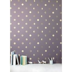 Metallic moon crescents create a starry night wallcovering. To maximize the dramatic effect of this whimsical wallcovering, add a Decorpro Twig sconce or a modern, contemporary Nuvo or Pure. (Shown: Moon Crescents Wallpaper)