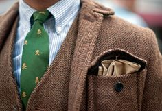 Pocket square and skulled tie.