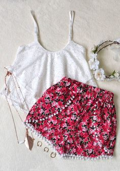 Give your lazy weekend a cheer in this pair of high-waisted shorts with super cute pompom-ball fringe.