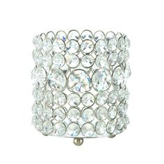 Rows upon rows of round crystalline gems stack up to create a dazzling candle holder that youll love to put on display. Golden metal surrounds each beautiful gemstone to give it glamorous shimmer and